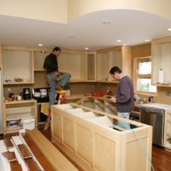 Kitchen Renovation Cost Cabinet Trim Installation How Professionals Estimate Remodeling Costs Two Men Working On A Remodel