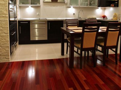 wood flooring for kitchen tables small spaces vinyl vs laminate a comparison brazilian cherry hardwood floors the basics