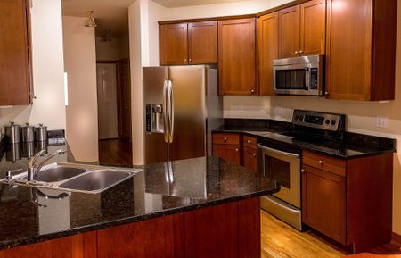 granite kitchen countertops pictures valances for windows quartz vs a comparison