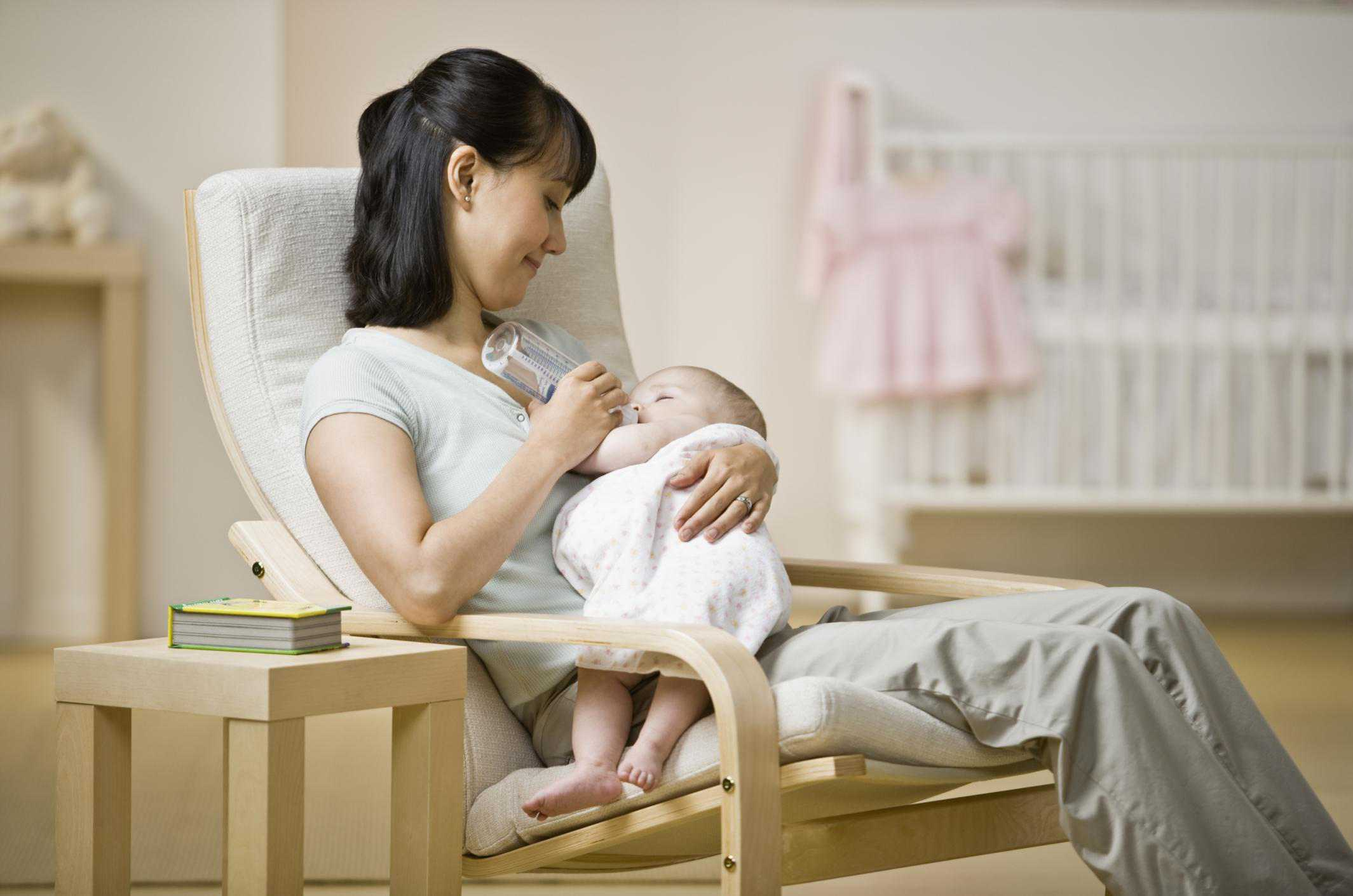 chairs for baby room target high chair 5 tips choosing a breastfeeding the nursery asian mother feeding