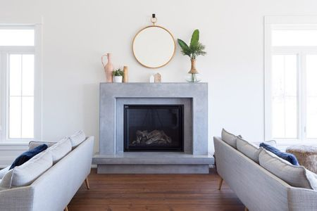 living room decorating ideas with stone fireplace light blue gray walls 18 stunning fireplaces for every style beautiful contemporary cast mantel