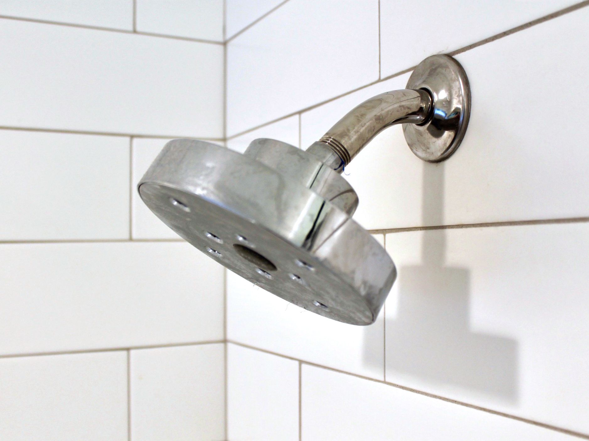 remove calcium deposits from a shower head