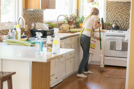 cleaning kitchen floors chinese knife the 7 best mops to buy in 2019 young woman mopping with green products
