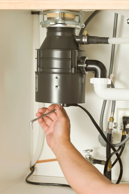 kitchen disposal cabinets storage troubleshooting garbage problems safety