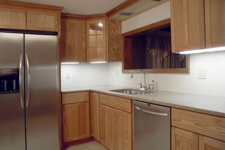 Learn how to redo your kitchen cabinets to give your kitchen a whole new look for little money. Refacing Vs Replacing Kitchen Cabinets