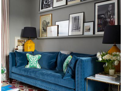 one sofa living room ideas built in wall cabinets placement tips for ideal function and balance not sure what to hang over your try of these 7 design