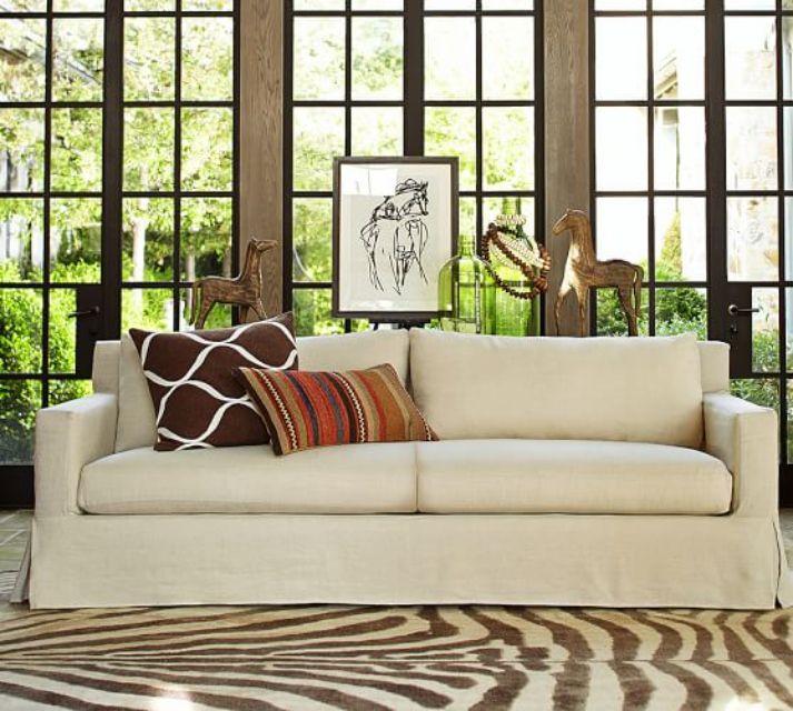 white slipcovered sofa living room simple and elegant decor the best sofas of 2019 york square arm