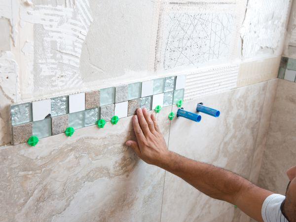 to repair water damaged tile shower walls
