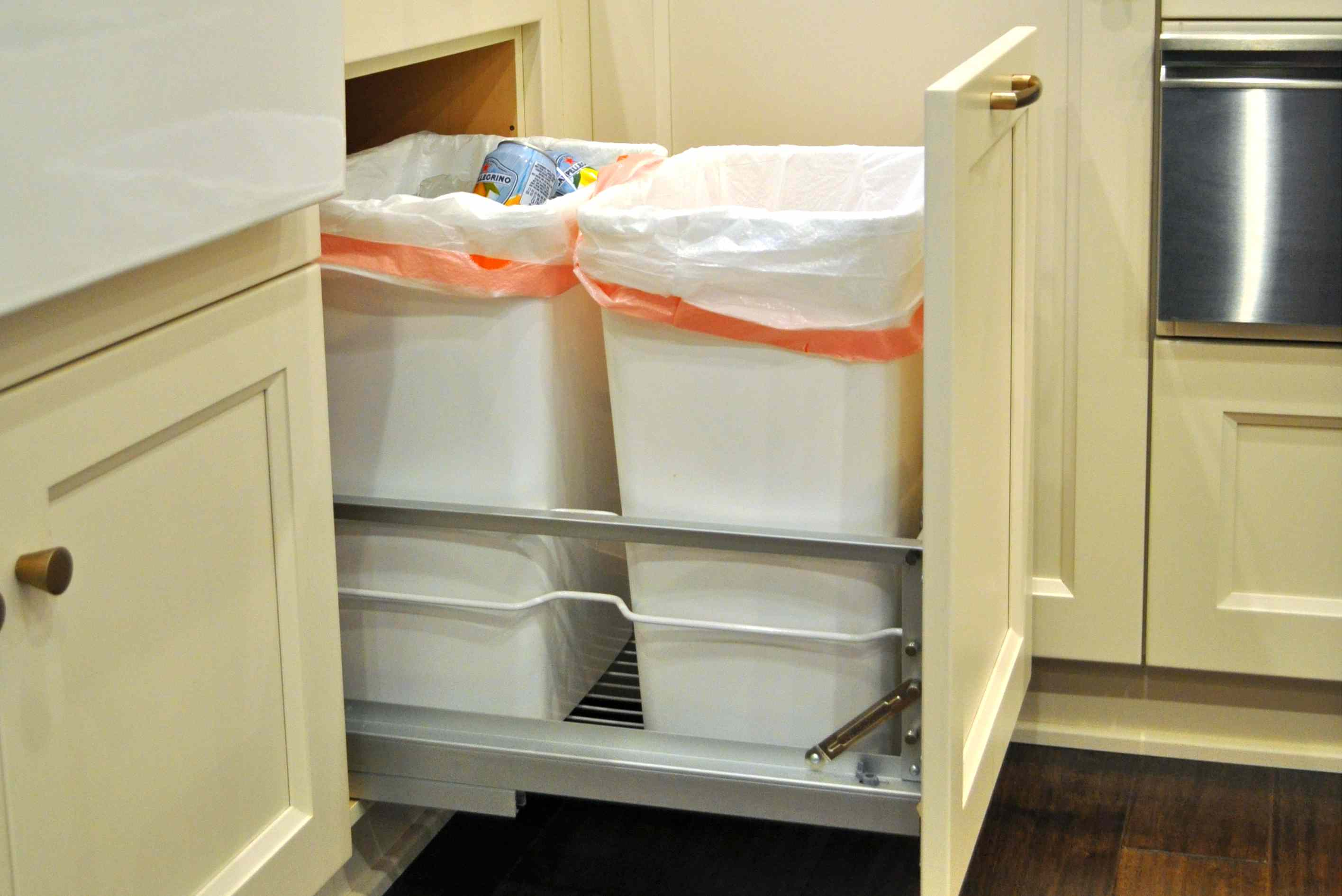pull out kitchen cabinet aid professional 6000 hd design essentials double trash