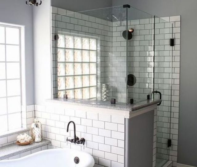 Bathroom With Tiled Shower And Clawfoot Tub