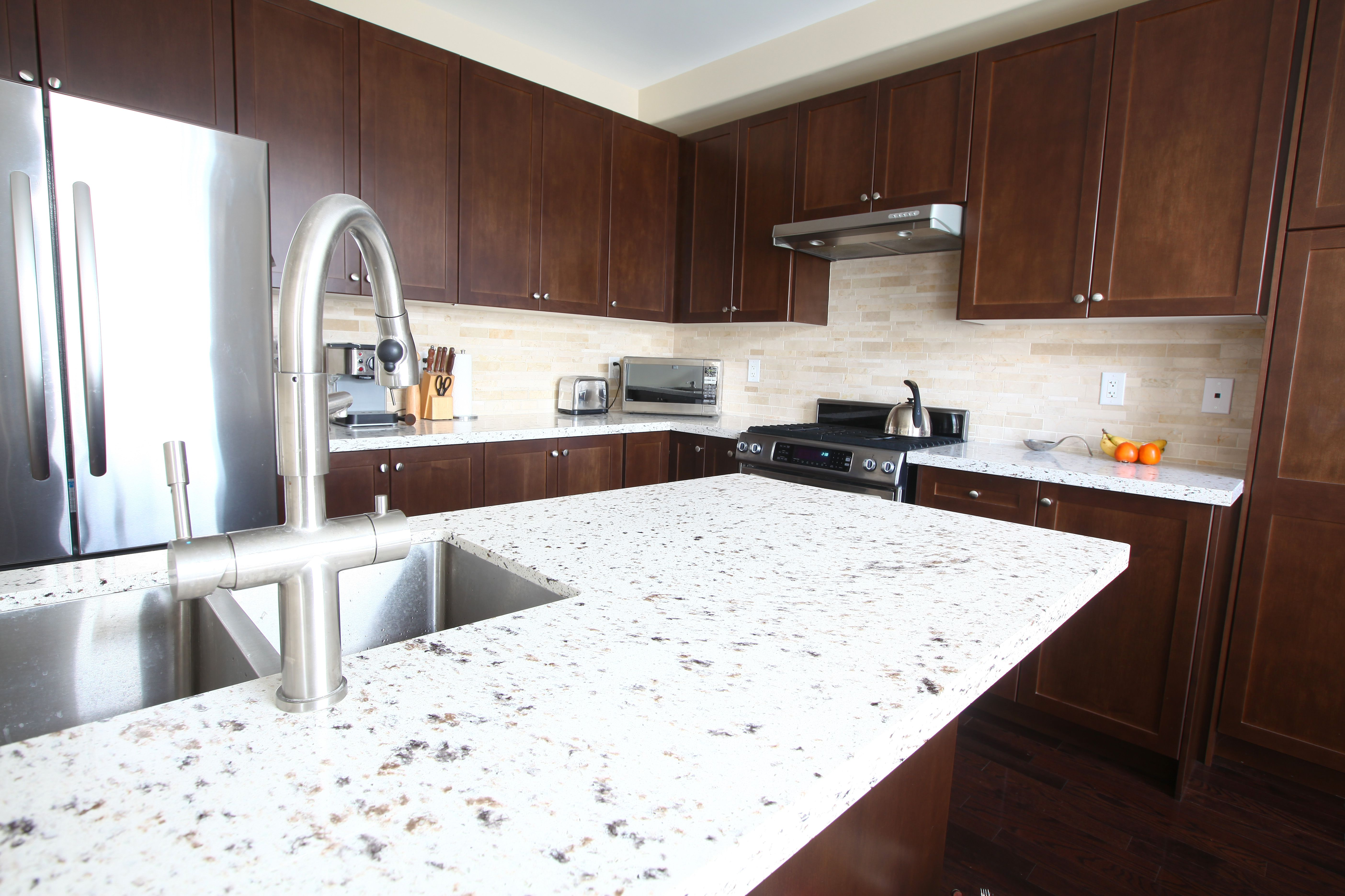kitchen countertops quartz cottage style chairs solid surface vs countertop domestic with and chestnut cabinets