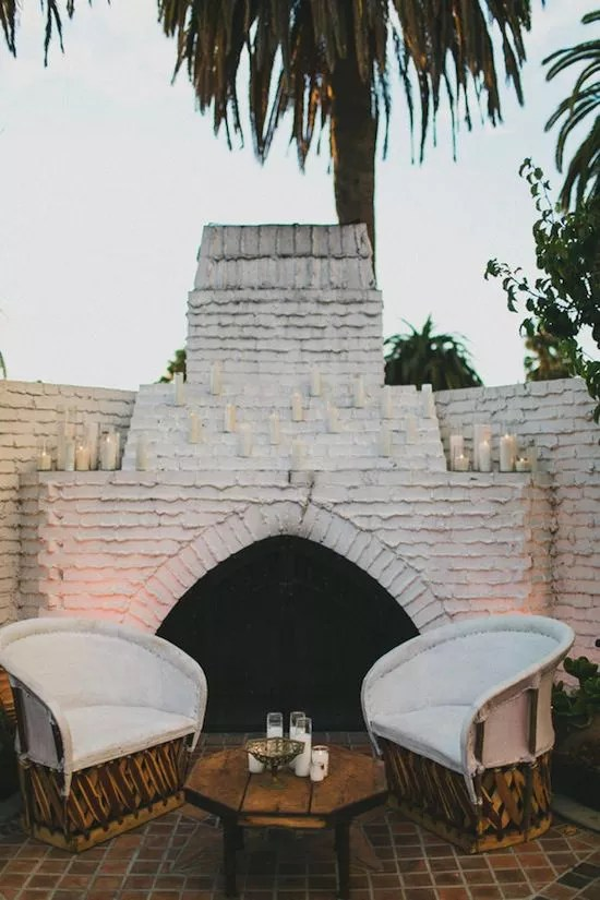 Equipale Chairs in front of outside fireplace.