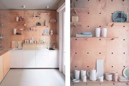 kitchen pegboard high gloss cabinets this studio apartment has a beautiful peg board storage wall in