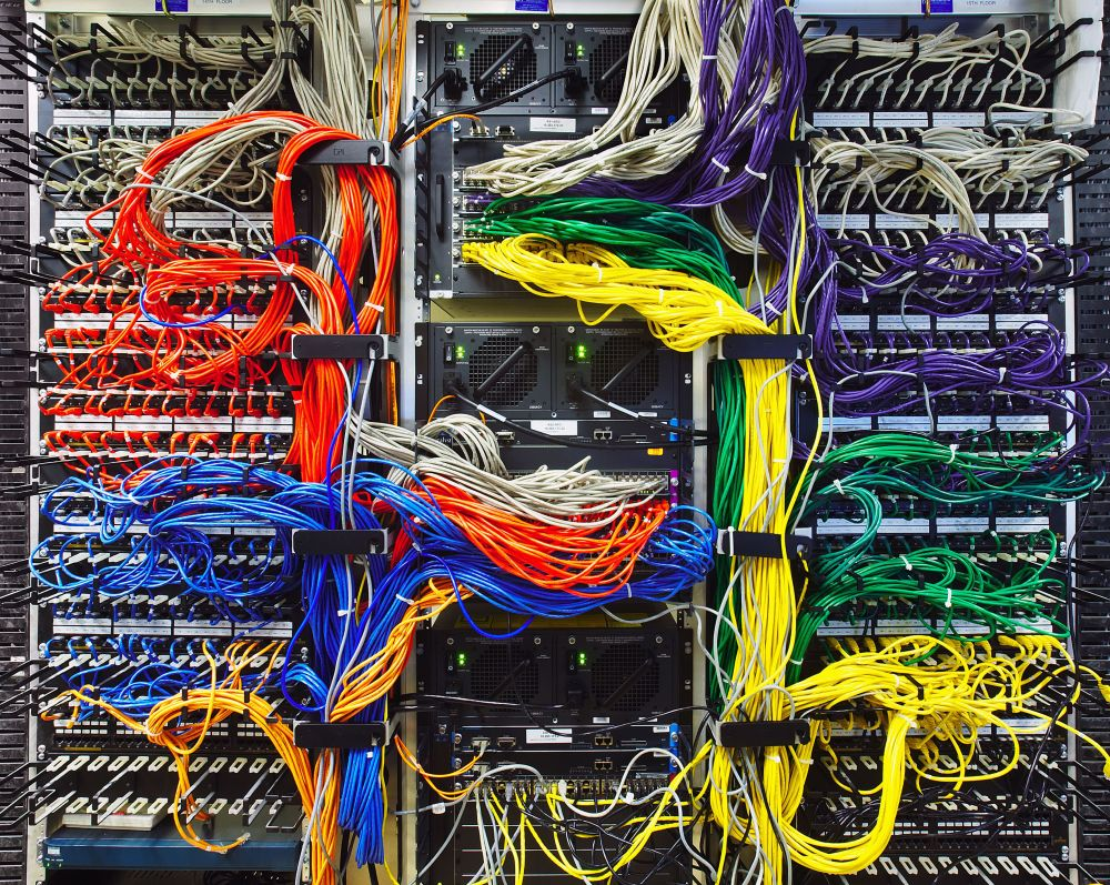 medium resolution of colorful computer wires in server room