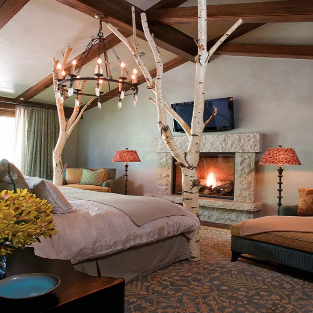 Tree trunk four poster bed