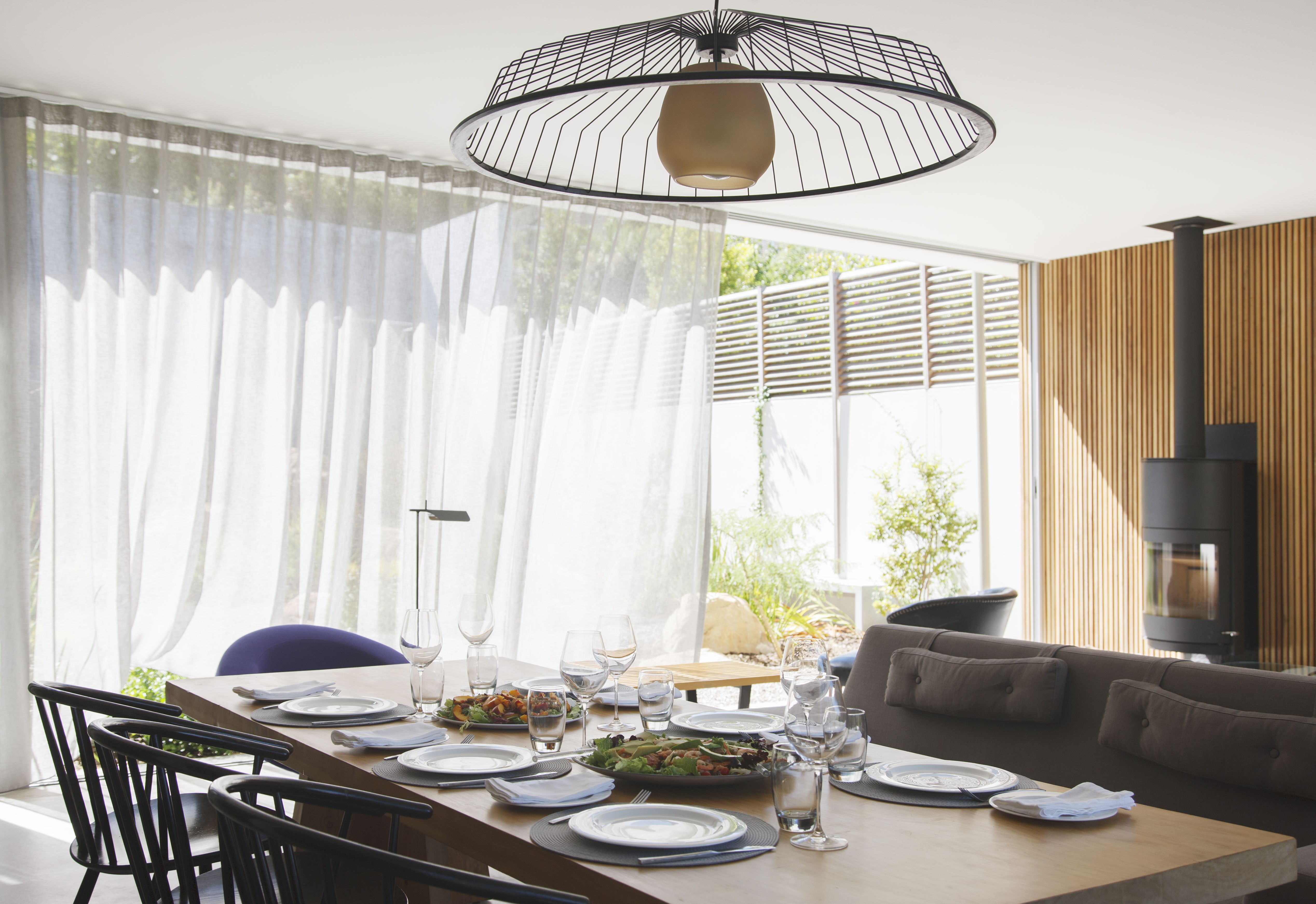 modern chandeliers for living room decor brown leather sofa how to soften your dining with curtains or drapes
