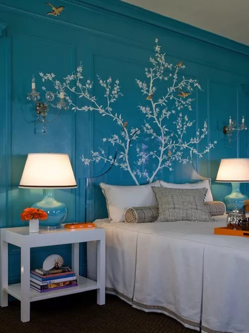 Beautiful bird and branch wall mural in bedroom
