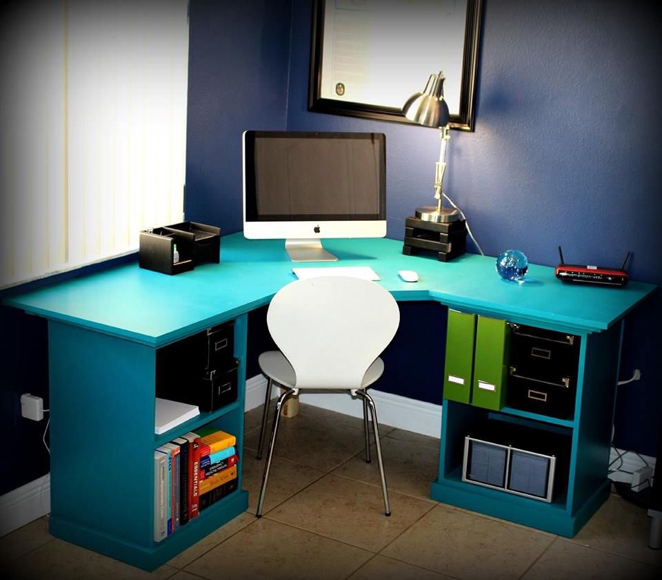 medium resolution of a blue computer desk