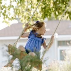 Swing Chair For 5 Year Old School Desks And Chairs 11 Free Wooden Set Plans To Diy Today Happy Girl Swinging On Rope At Front Yard