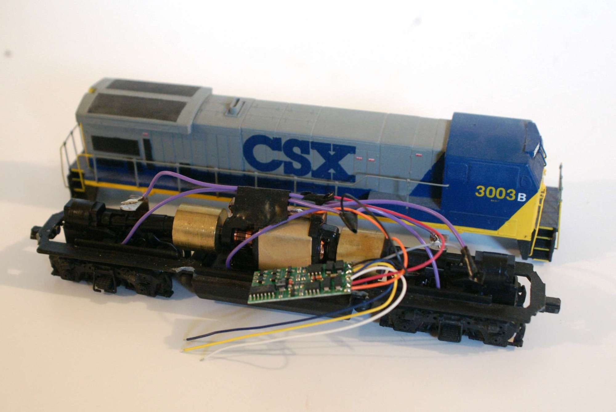 hight resolution of this nce decoder is installed on an athearn ho locomotive frame and motor the shell is a modified bachmann model the decoder and wires are held to the top
