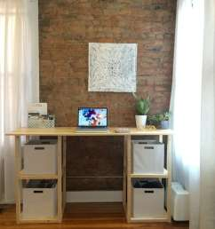 a diy desk by a brick wall and windows  [ 1632 x 1224 Pixel ]