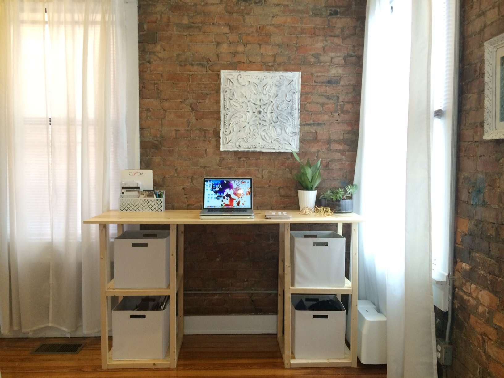 hight resolution of a diy desk by a brick wall and windows