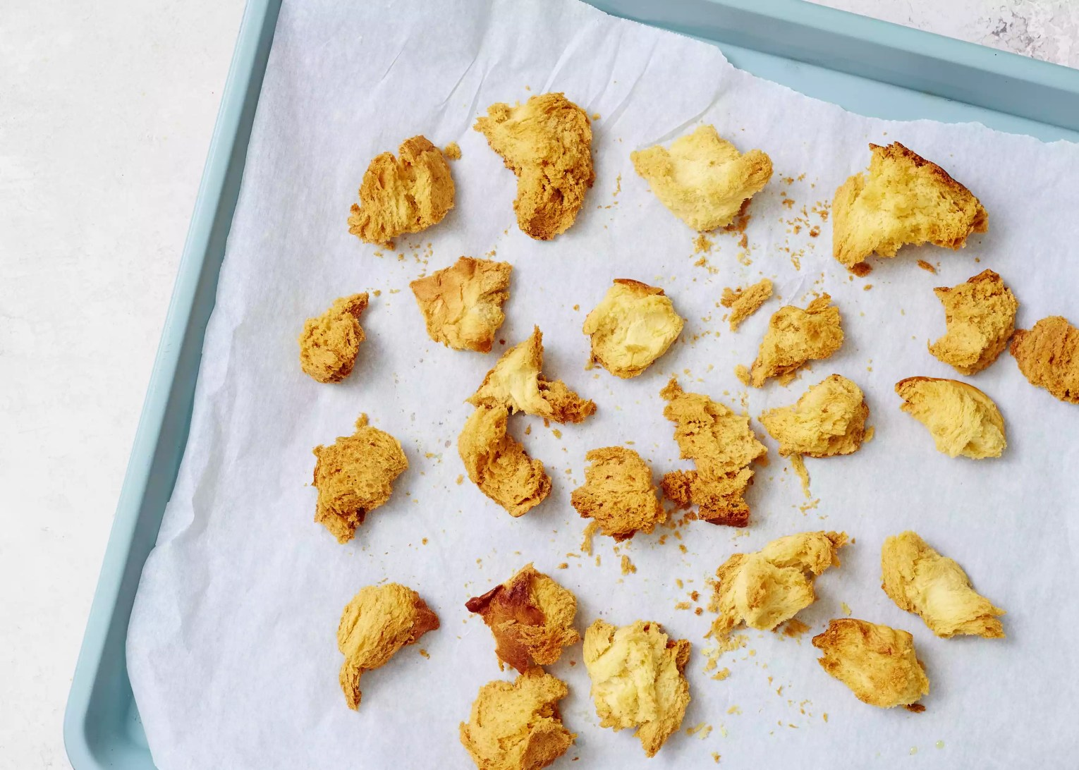 croutons on a parchment paper lined baking sheet