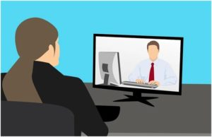 A sketch of a man and a woman in a video conference