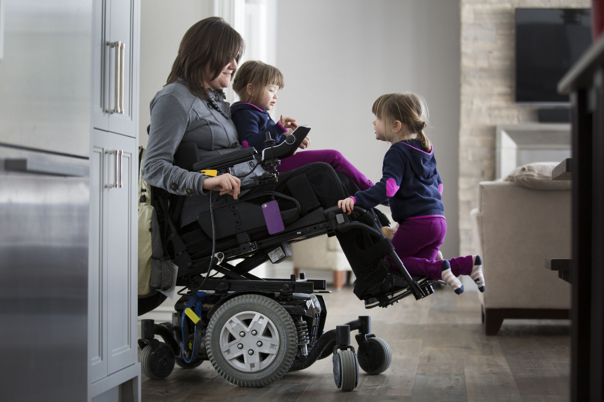 quadriplegic wheelchair unusual high back chair mom raising twin girls faces extra hurdles