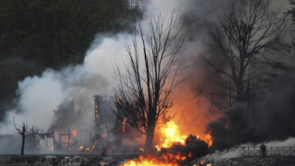 The town continued to burn following a train derailment and explosion in Lac Megantic, Quebec.