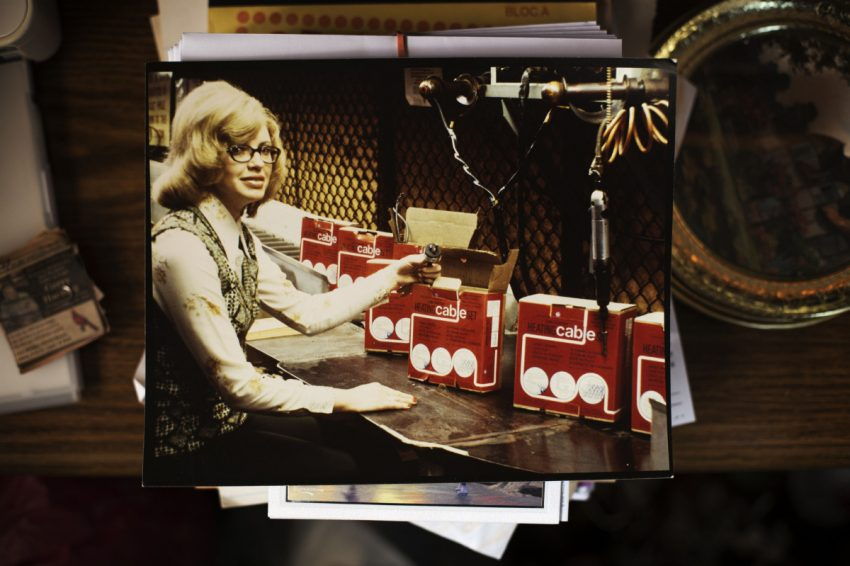 Marilyn Harding, who worked at General Electric for almost 40 years and has survived bladder and breast cancer, is shown in a photo assembling lead heating cables.