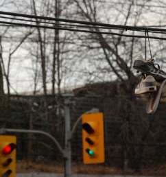 shoes dangle from wires overhead all over toronto what does it mean the star [ 1200 x 803 Pixel ]