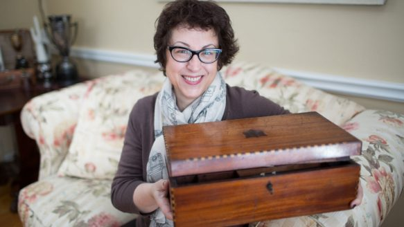 Marlee Petroff shows off a lap desk once owned by immigrant George Bremner, whose contents her father had preserved inside through three decades.