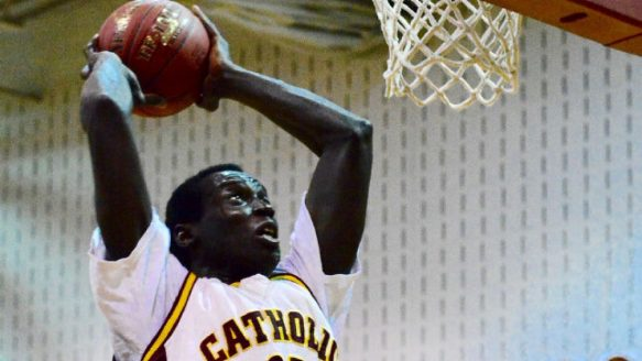 Jonathan Nicola, 29, was detained by Canada Border Services Agency officials after allegedly posing as a 17-year-old high school student in Windsor. The 6-foot-9 Nicola is shown in action on the Catholic Central High School's basketball team.
