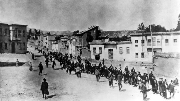 Ottoman Armenians are marched to a prison in Kharpert, Armenia, by armed Turkish soldiers in April 1915. Up to 1.5 million Armenians were killed in what is now recognized as the 20th century's first genocide.<br />
