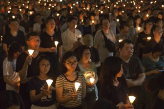 Thousands of people attended a candlelight vigil in Hong Kong on Sunday.