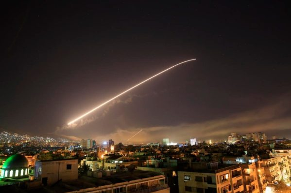 The Damascus sky lights up with surface-to-air missile fire as the U.S. launches an attack on Syria early Saturday.