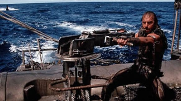 Kevin Costner in the vast blue expanse of Waterworld. The movie was a flop but perhaps prophetic.