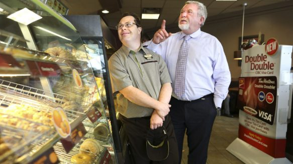 Mark Wafer (right) employs 46 people with disabilities at his six Tim Hortons in Toronto, including Clint Sparling (left) who has worked for Wafer for nearly 20 years.