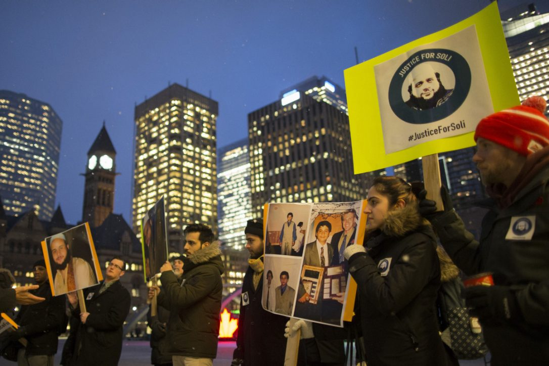 A small group of family and friends of Soleiman Faqiri hold a vigil at Nathan Phillips Square in February for the mentally ill man who died during an altercation with guards in jail in Lindsay, Ont.