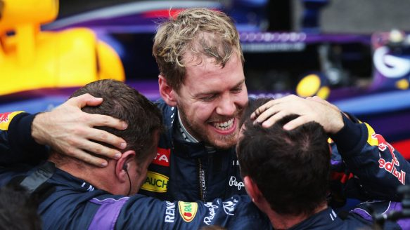 Sebastian Vettel celebrates with crew members after winning Sunday's Brazilian Grand Prix, his 13th victory of the Formula One season.