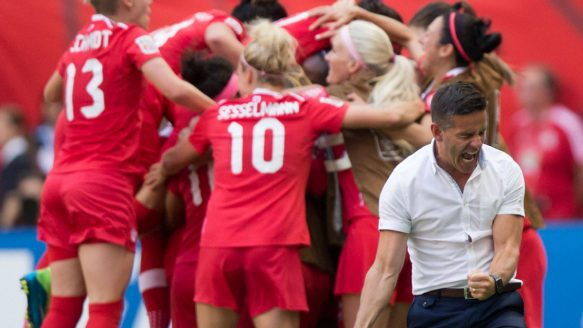 Canada coach John Herdman, right, celebrates as Josee Belanger, back, is mobbed by her teammates after scoring against Switzerland during second half FIFA Women's World Cup soccer action in Vancouver, B.C., on Sunday June 21, 2015.