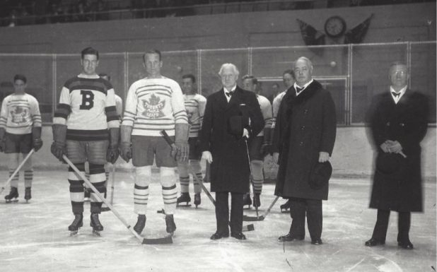 At a Toronto Maple Leafs game, players stand with Lieut-Gov. Herbert A. Bruce, J.P. Bickell, second from right, and Frank Calder, the president of the NHL.