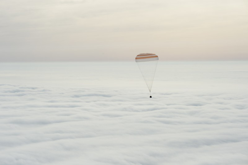 Soyuz TMA-18M spacecraft, floating back to Earth
