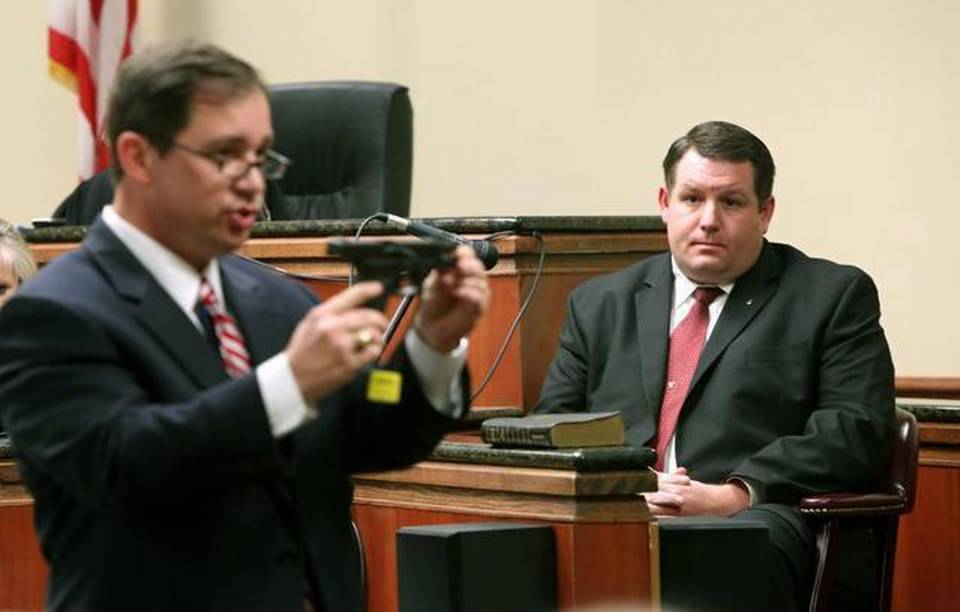 Solicitor David Pascoe cross-examines former Eutawville police chief Richard Combs in January while holding the gun Combs used in the shooting death of Bernard Bailey, an unarmed black man, in May 2011. Pascoe said he intends to bring Combs to trial again after the jury announced it could not reach a decision and the judge declared a mistrial.