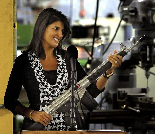 Gov. Nikki Haley looks over a personalized PTR semi-automatic rife she was presented during a tour of the Aynor plant last year.