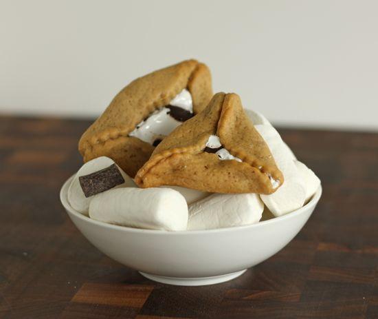 Hamantaschen- get the recipe for S'more hamentashen. Graham cracker dough with a gooey marshmallow and chocolate center