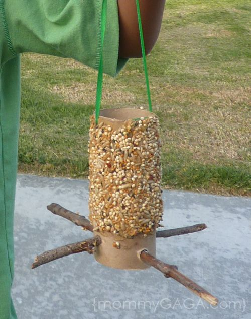 Love this Bird Feeder DIY tutorial for Mommy Gaga--which involves a simple upcycling of a toilet paper tube, 2 sticks, peanut butter and seeds (can be sesame) if you do not want to buy bird seeds