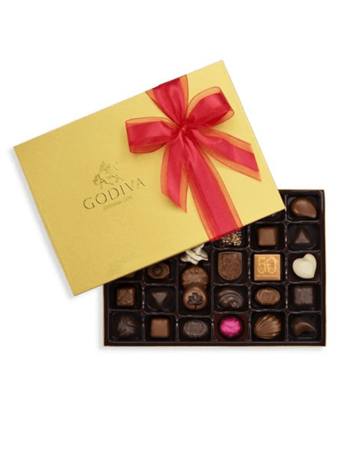 Make your Valentine's Day gift extra special with this red ribbon-tied gold gift box filled with 36 luscious chocolates. In each piece you will discover exquisitely rich chocolate. Includes 36 milk, dark, and white chocolates with classic Belgian fillings, such as silky ganaches, creamy pralines, rich caramels, plus fruits and nuts