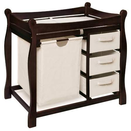 Badger Basket's smart Sleigh Style Baby Changing Table with Hamper and 3 Baskets is an all-in-one station for changing and dressing your baby and keeping dirty clothes out of sight. Removable drawers and hamper so you can see everything inside and easily tote Baby's soiled duds to the laundry room